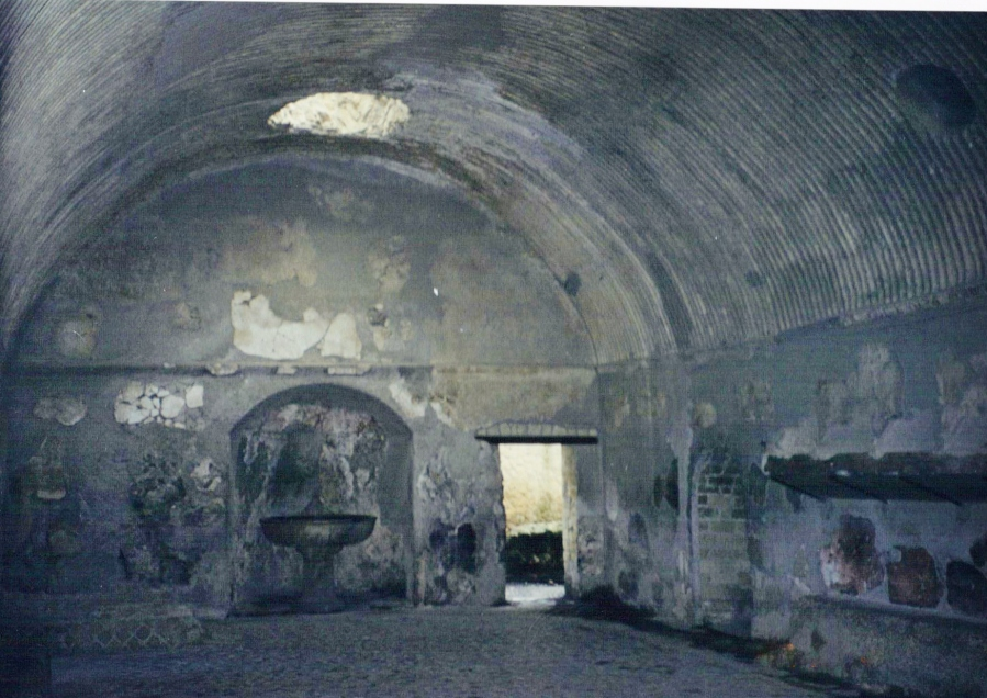 Men's changing room of the Forum Baths, Herculaneum. The surviving stucco and painted decoration is superb.