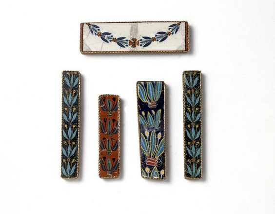 An Assemblage of Romano-Egyptian Mosaic Glass Inlays with Trefoil Garland Patterns and a Festoon