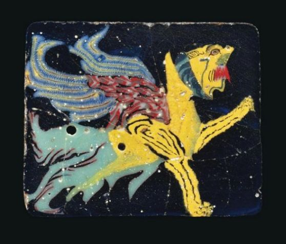 AN EGYPTIAN MOSAIC GLASS GRIFFIN INLAY PTOLEMAIC PERIOD, CIRCA 2ND-1ST CENTURY B.C.